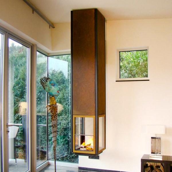 vierseitig verglaster zentralkamin. Black Bedroom Furniture Sets. Home Design Ideas